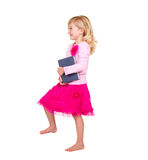 Child holding book stepping Royalty Free Stock Photo