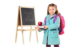 A child holding books and apple Royalty Free Stock Image