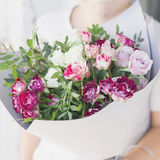 The child holding bouquet of spray roses. Toned photo Stock Photography