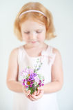 Child holding a bouquet of summer flowers Royalty Free Stock Photos