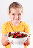 Child holding a bowl of fresh cherries Stock Photos