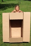 Child holding a box Stock Photos