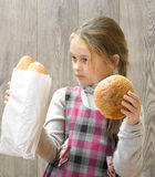 Child holding a bread Royalty Free Stock Photo