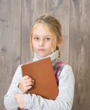 Child holding a brown book Stock Photography