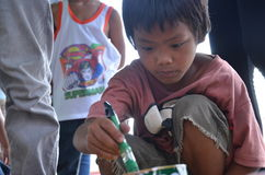 Child holding brush paint. Child holding a brush paint during the art workshop at Bayombong, Nueva Vizcaya, Philippines stock photo