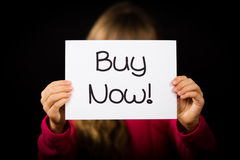 Child holding Buy Now sign Stock Image