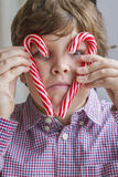 Child holding candy canes Stock Image