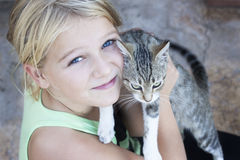 Child holding cat Royalty Free Stock Photo