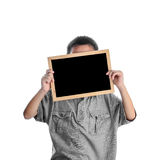 Child holding a chalkboard on white Stock Images