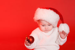 Child holding christmas decorations closeup Royalty Free Stock Photography