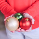 Child holding christmas decorations closeup Stock Photos