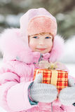 Child holding Christmas gift Stock Images