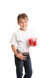 Child holding Christmas gift stock images