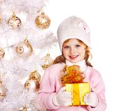 Child holding Christmas  gift box. Royalty Free Stock Photo