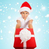 Child holding Christmas gift box in hand.  on background Stock Photography