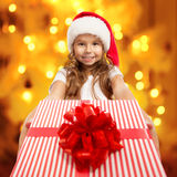 Child holding Christmas gift box in hand. Royalty Free Stock Photo