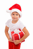 Child holding Christmas gift box in hand. Isolated Stock Photo