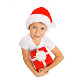 Child holding Christmas gift box in hand. Isolated Royalty Free Stock Photos