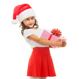 Child holding Christmas gift box in hand. Isolated Royalty Free Stock Image