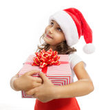Child holding Christmas gift box in hand. Isolated. On white background. Holidays, christmas, new year, x-mas concept royalty free stock photos