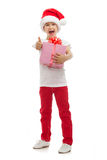 Child holding Christmas gift box in hand. Isolated Stock Images
