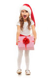 Child holding Christmas gift box in hand. Isolated