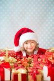 Child holding Christmas gift boxes Royalty Free Stock Image