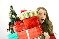 Child holding Christmas gifts Royalty Free Stock Photography