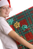 Child holding Christmas present vertical Stock Image