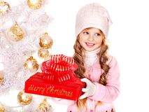 Child  holding  Christmas red gift box . Stock Photography