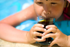 Child holding cola drink Stock Images