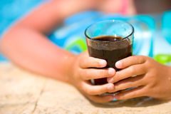Child holding cola drink Royalty Free Stock Image