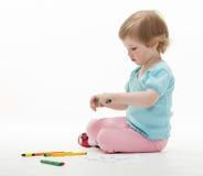 Child holding colorful felt-tip pens Stock Image