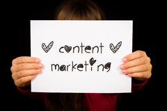 Child holding Content Marketing sign Stock Photo