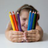 Child holding crayon. Portrait of child holding crayon before face Royalty Free Stock Images