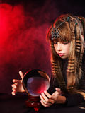 Child  holding crystal ball. Stock Photo