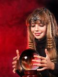 Child  holding crystal ball. Stock Images