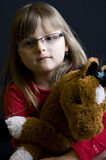Child holding cuddly toy Stock Photos
