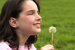 Child Holding Dandilion Looking Up Stock Photos