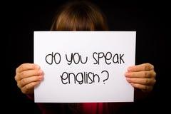 Child holding Do You Speak English sign Stock Photo