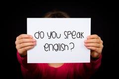 Child holding Do You Speak English sign Stock Photography