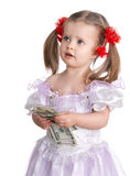 Child holding dollar money. Royalty Free Stock Image