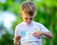 Child holding drawing Stock Photo