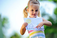 Child holding drawing Stock Photography