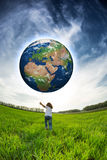 Child holding Earth in hands Stock Photo