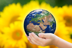Child holding Earth in hands Stock Photography