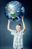 Child holding the earth in his hands Stock Photos