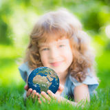 Child holding Earth planet in hands Stock Image