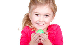 Child holding easter egg Stock Photos