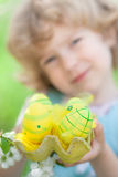 Child holding Easter eggs Stock Photography